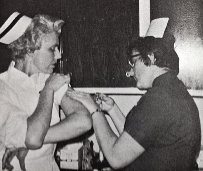 Mrs Hitz gets an injection from our classmate