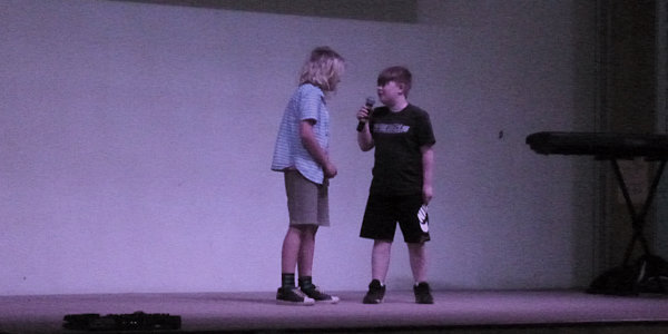 Curtis's Talent Show (Curtis is the taller kid on the left with long blonde hair)
