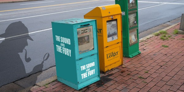 Newspaper stands on street