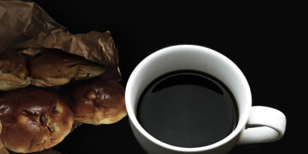 Cup of coffee with raisin buns