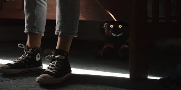 Teddy bear monster under a bed