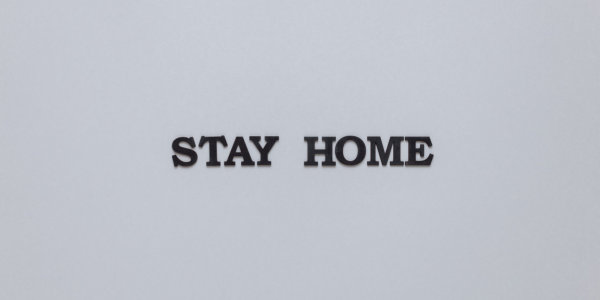 """""""Stay Home"""" in black letters on white background"""